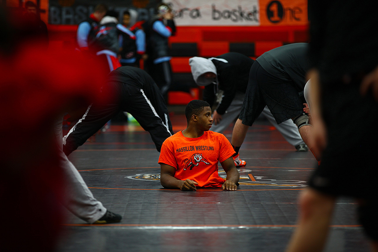 zion001  Massillon, Ohio 1/30/2016 Senior wrestler Zion Shaver warms up with his team at the Tiger Invatational at Massillon Washington High School in Massillon, Ohio. Coaches and teamates say that Zion is a inspiration to many on and off the mat.